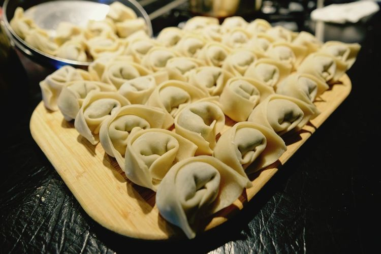 Close-Up Of Chinese Food Wontons On Cutting Board