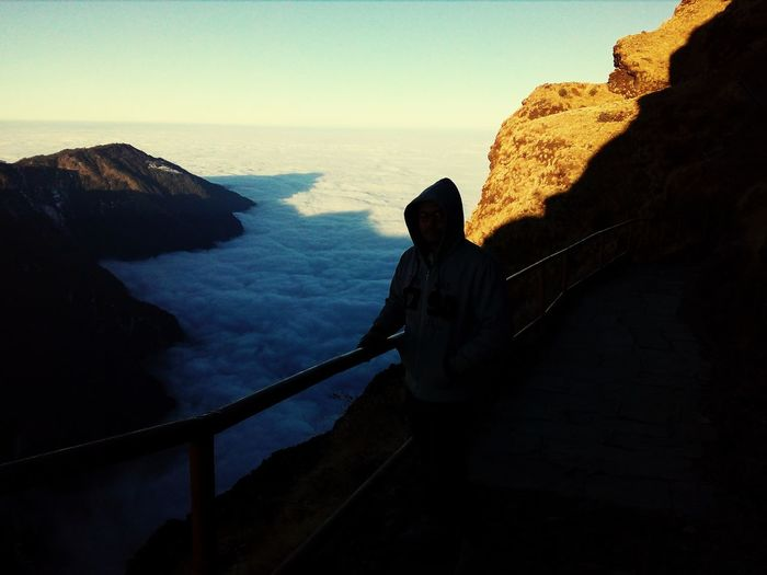 world above clouds Above The Clouds Clouds Cloud - Sky Climbing Adventure Full Length Silhouette Exploration Discovery Sky Cliff Rock Formation Geology Steep Physical Geography Rocky Mountains Natural Arch Rock Sandstone Hiker Free Climbing