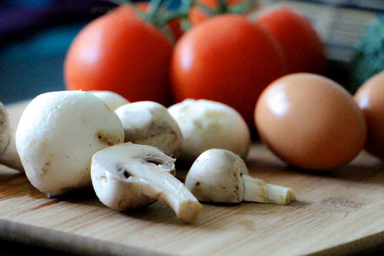 Mushroom egg and tomatoes on cutting board