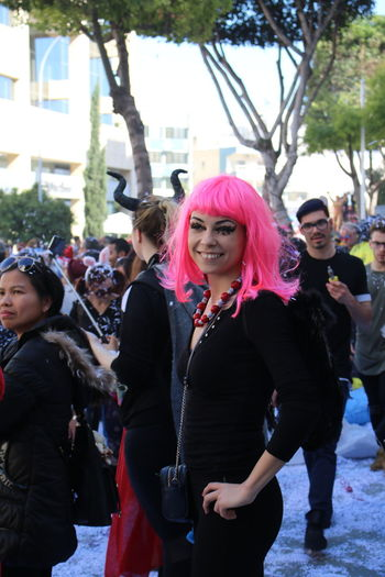 Carnival season in Limassol Carnival Carnival Crowds and Details Pretty Girl Festival Carnival Cyprus EyeEmFestival Pink Wig Day Dyed Hair Fashion Fashion Model Front View Leisure Activity Lifestyles Outdoors Real People Standing Young Adult Young Women Arts Culture And Entertainment Smiling Portrait Well-dressed People