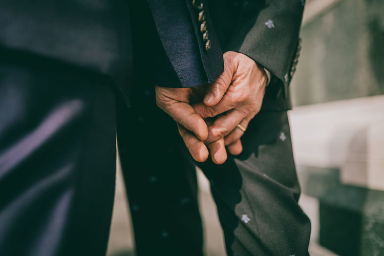Close-up of business people holding hands
