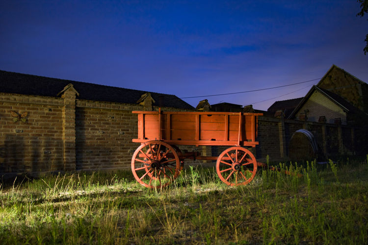 Architecture Building Exterior Built Structure Field Grass History Illuminated Nature Night No People Outdoors Sky Wagon Wheel Wheel