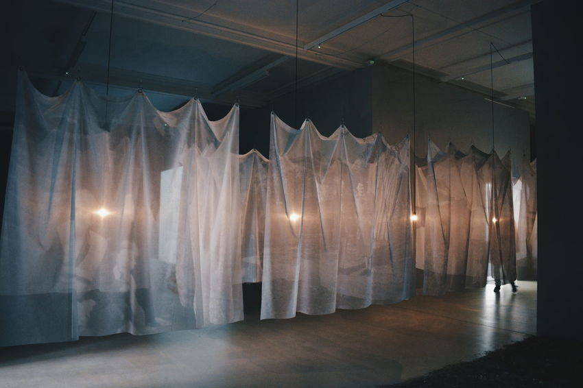 Christian Boltanski Exhibition Christian Boltanski Death Life Absence Architecture Ceiling Curtain Decoration Empty Exhibition Flooring Hanging Illuminated Indoors  Installation Lighting Equipment Memory Nature Night No People Stage Stage - Performance Space Textile Transparent Window