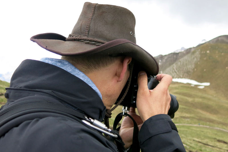 Side View Of Male Hiker Photographing Mountains