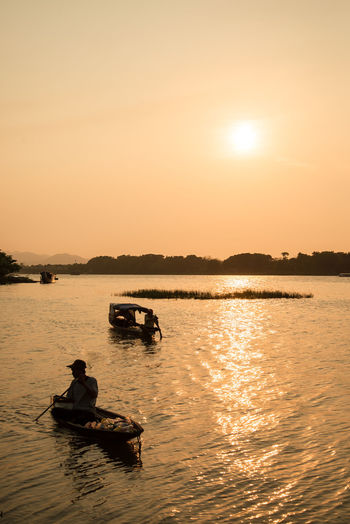 Huong River Huế Beauty In Nature Leisure Activity Lifestyles Mode Of Transportation Nature Nautical Vessel Orange Color Outdoors People Real People River Scenics - Nature Sea Silhouette Sky Sunset Transportation Water Waterfront