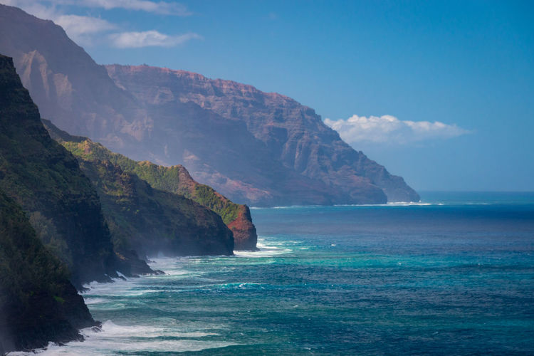 Scenic view of napali coast on kauai island, hawaii seen from kalalau hiking trail against sky