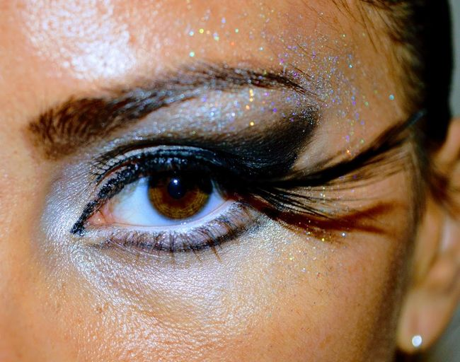 Close-up portrait of woman with eyeshadow