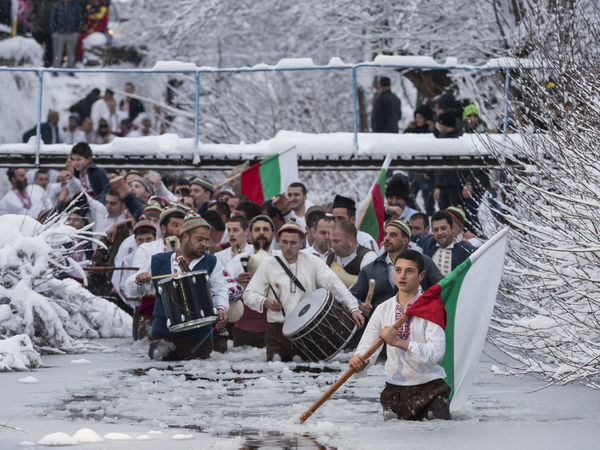 Jordan's Day celebrations in Kalofer, Bulgaria. The celebrants commemorate Jesus being baptised in the river Jordan by dancing in the icy river. The local priest then throws a cross into the water and they have to attempt to catch it. Celebration Dancing Dancing Around The World Day Epiphany Festival Folklore Kalofer Large Group Of People Music Musician Outdoors Parade People Playing Reportage Ritual River River Dance Snow Tradition Traditional Culture Winter The Photojournalist - 2018 EyeEm Awards