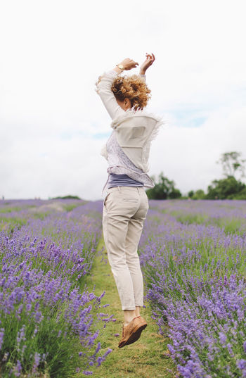People And Places Blonde Casual Clothing Curly Hair Field Flower Full Length Growth Joy Jumping Landscape Lavanda Lavander Lavander Flowers Lavanderfields Leisure Activity Lifestyles LV Nature Plant Playful Sky Summer Surrey Tranquil Scene
