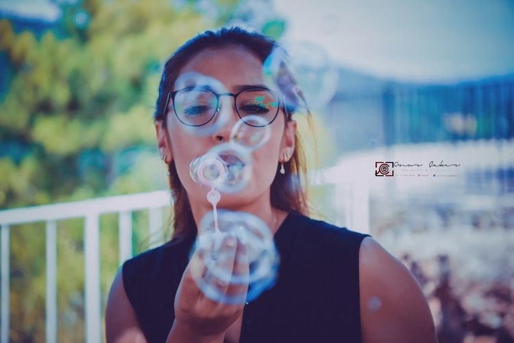 One Woman Only Adult One Person Eyeglasses  Adults Only Only Women People Holding Headshot Futuristic Young Adult Women One Young Woman Only Cyberspace Day Bolu TURKEY Outdoors Bubble Wand Close-up