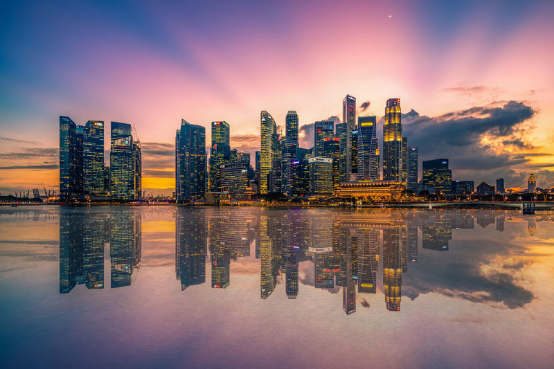 Architecture Business Business Finance And Industry City City Life Cityscape Corporate Business Downtown District Finance Harbor Igniting Illuminated Landscape Long Exposure Modern Multi Colored Night Outdoors Reflection Sky Skyscraper Sunset Travel Travel Destinations Urban Skyline