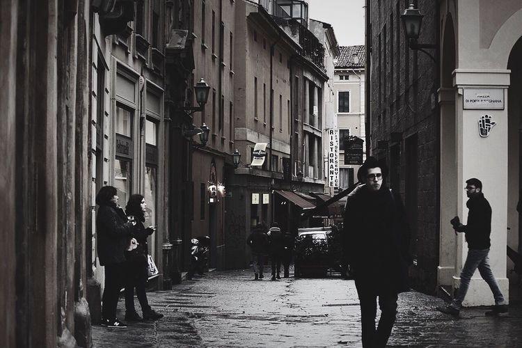 Full length of people walking in city