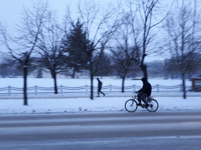 Man with bicycle in winter