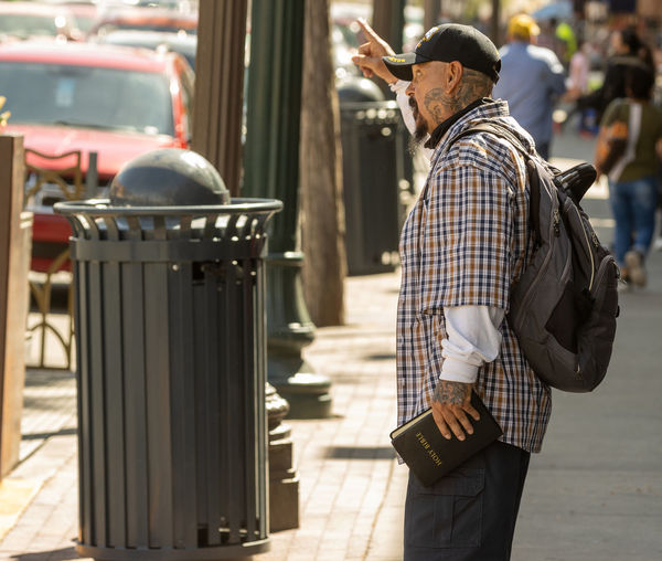 Side view of man standing on street