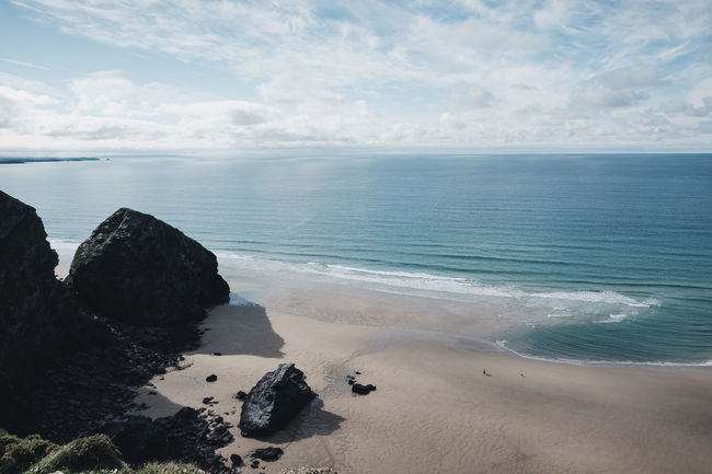 Cornwall, UK Sunny Beach Beach Day Beauty In Nature Bedruthan Steps Cloud - Sky Cornwall Day Daydreaming Horizon Horizon Over Water Idyllic Land Nature Non-urban Scene Ocean Person On Beach Rock Sand Scenics - Nature Sea Sky Tranquil Scene Tranquility Water