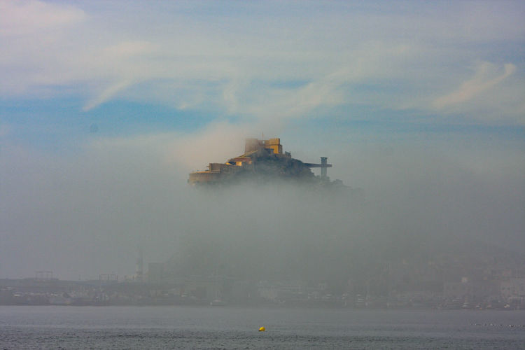 Castle in sea against sky