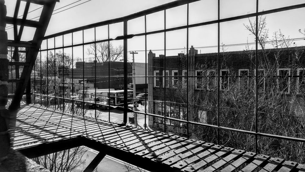 Architecture Black & White Photography Built Structure Day Downtown Fire Escape Graham NC High Contrast Bnw Indoors  Intersection Lines And Shadows Lines And Shapes Manmade Beautiful Metal Metalwork No People Railing Shapes , Lines , Forms & Composition Shapes And Forms Sky Small Town America Street Corner Street Scene Streetscape Uban Life