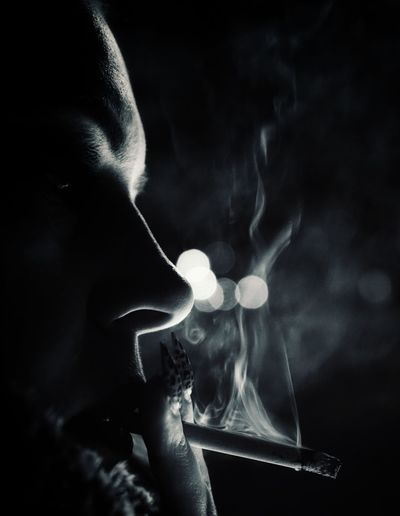 Close-up of cigarette smoking at night