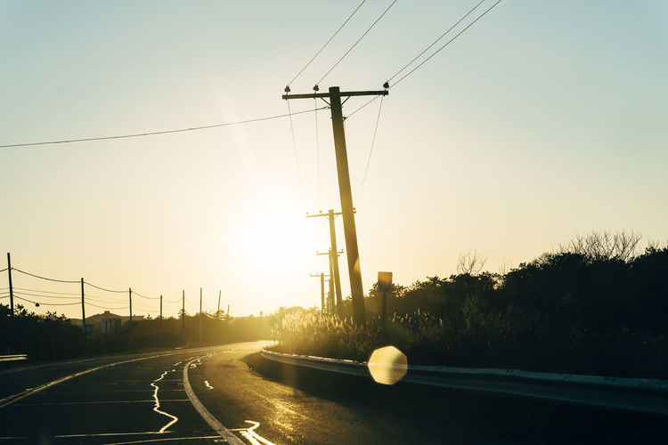 Day Electricity Pylon Horizon Nature No People Outdoors Road Roadtrip Sky Sunlight Sunset