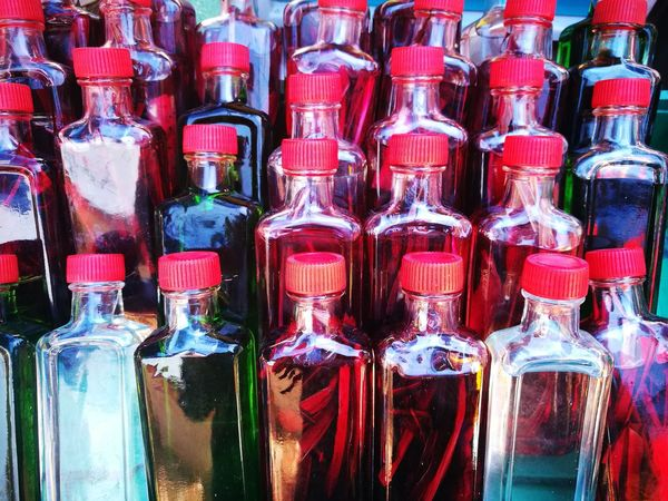 Traditional medicine bottle Massage Therapy Massage Oil Coconut Virgins Oil Full Frame Backgrounds Bottle Close-up Display Shop Collection Retail Display For Sale