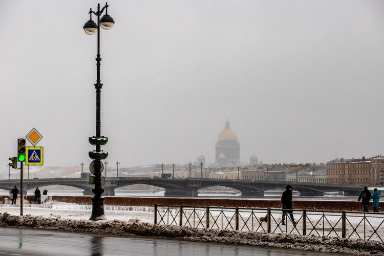 Architecture Built Structure Building Exterior Travel Destinations Street Light City Water Sky Nature Bridge Bridge - Man Made Structure Building Travel Cold Temperature Transportation Street Winter River Government Outdoors Snowing Russia St. Petersburg St. Petersburg, Russia