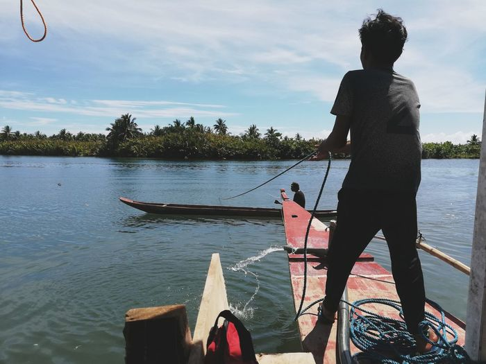 Sea life Calaguas EyeEm Selects Water Men Low Section Standing Nautical Vessel Lake Full Length Sky Cloud - Sky Fisherman