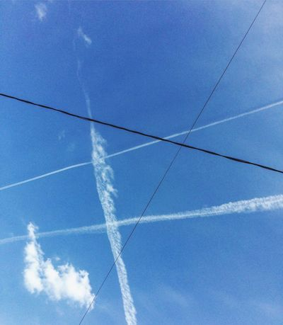Vapor Trail Blue Low Angle View Contrail Day Outdoors Sky No People Nature Beauty In Nature