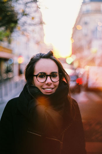 Here's to days ending with a smile. Portrait City Young Adult Looking At Camera Street Smiling Women Happiness 50mm EyeEmNewHere Film Photography Film Filmphotography Woman Minolta Minolta Maxxum Portraits Portrait Of A Woman Paris, France  Paris