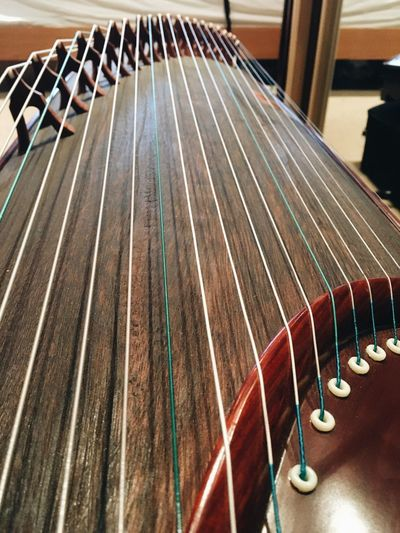 Guzheng - traditional Chinese zither. Guzheng Zither Music Musical Instrument Arts Culture And Entertainment String Instrument Musical Equipment Musical Instrument String String Guitar Pattern Close-up Repetition High Angle View Day Wood - Material In A Row No People Indoors  Metal Large Group Of Objects Side By Side