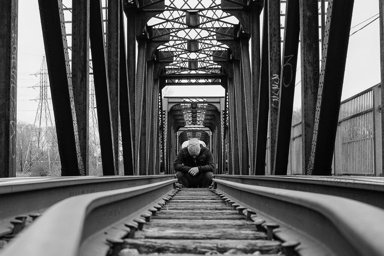 Architecture Bridge Bridge - Man Made Structure Contemplation Man Men One Person Railroad Railroad Bridge Sad Sadness Spirituality Train Tracks Black And White Friday