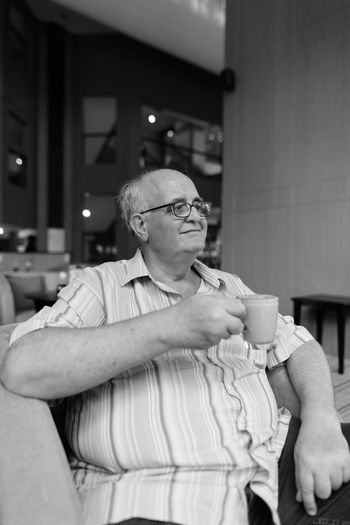 Man holding coffee cup