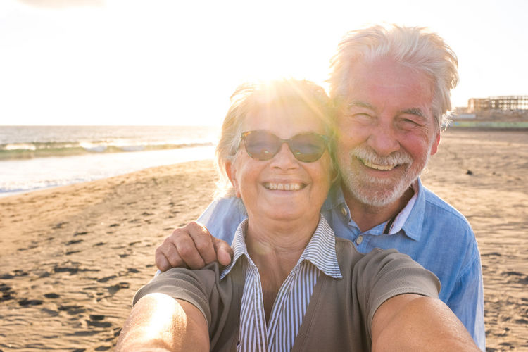 Portrait of smiling young couple on beach