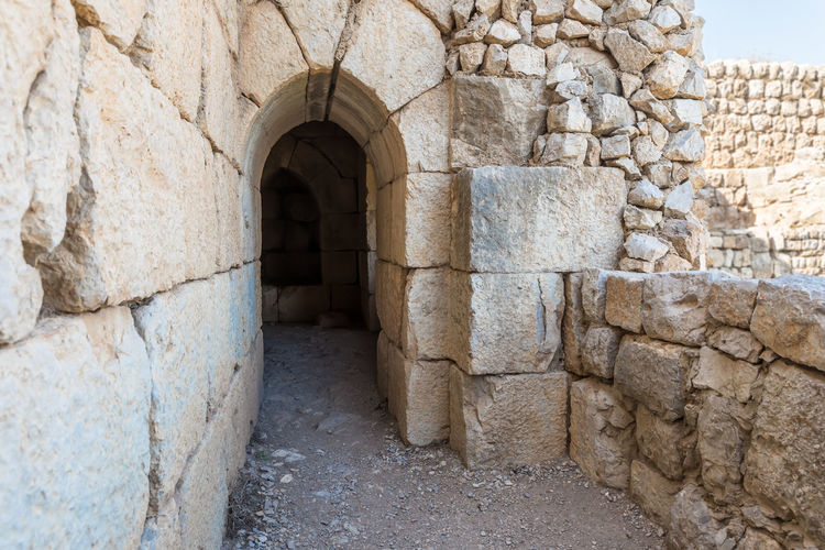 Passage through the fortress wall in Nimrod Fortress located in Upper Galilee in northern Israel on the border with Lebanon. History Israel Nimrod Fortress Castle Border Stone Material Wall - Building Feature Saladin Beybars Crusaders Ayubids Mamluks Assassins Tower Heritage Travel Destinations National Park Hill Old Ancient Architecture Medieval Ruin Protection Fort Gate