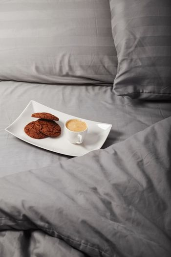 Always Be Cozy Bed High Angle View Food And Drink Indoors  No People Sheet Crumpled Tablecloth Food Healthy Eating Freshness Close-up Day Cookies Chocolate Espresso Pillow Blanket Relaxation Bed Warm Drink Bedroom Coffee - Drink