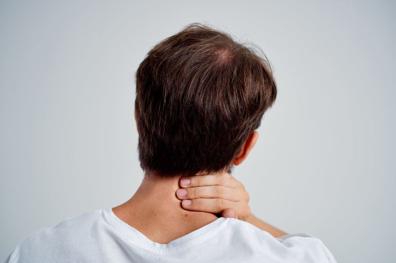 Rear view of man against white background