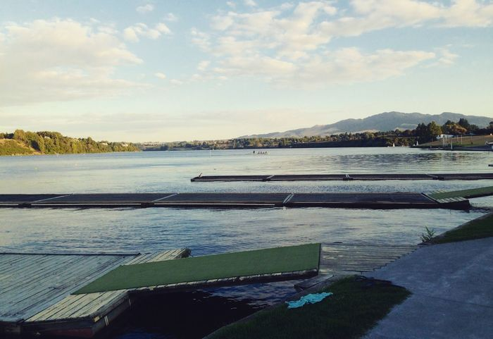 Pontoons & mountains #watersports Water Lake Sky Scenics Tranquility Tranquil Scene Nature Mountain Landscape Outdoors Beauty In Nature Day