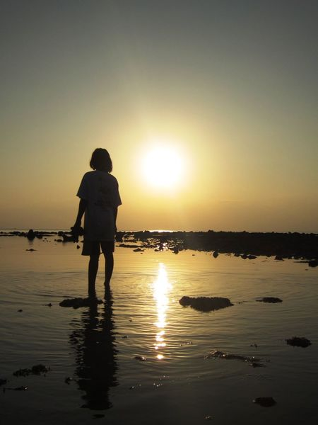 girl waiting for the sunset Beauty In Nature Childhood Sea Serenity Silhouette Sunset Tranquility Waiting EyeEmNewHere Sommergefühle