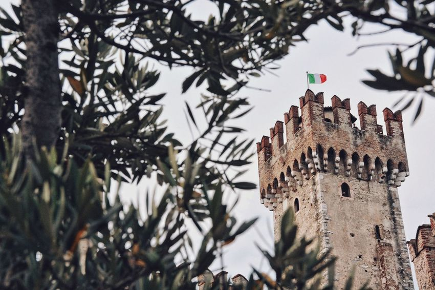 It could be any year. Italian Flag Italian Architecture Flag Fortress Castle Building Exterior Built Structure Architecture Tree Building Plant Nature The Past History Travel Destinations Tower Travel Tourism