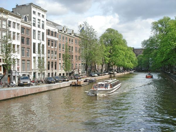 Your Amsterdam River Boats City Life Amsterdam Holland City Taking Photos Netherlands Showcase April Nature Green Tree Amesterdao Water Reflections Green Buildings Colorful
