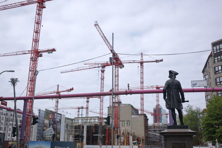 Architecture Art And Craft Baukräne Building Exterior Built Structure City Construction Site Crane - Construction Machinery Creativity Day Fritz Human Representation Low Angle View Male Likeness Men Occupation Outdoors People Sculpture Sky Statue Wilhelmstraße Working