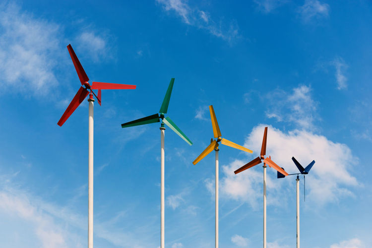 Airplane Blue Cloud - Sky Day Flying Industrial Windmill Low Angle View Nature No People Outdoors Sky Wind Power Wind Turbine Windmill