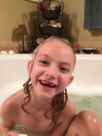 EyeEm Selects Bathtub Domestic Bathroom Water Looking At Camera Smiling Childhood Wet Portrait Real People Leisure Activity Bathroom Domestic Room Happiness Hygiene Taking A Bath Lifestyles Elementary Age Home Interior One Person Indoors  Selected For Premium Bubbles Open Mouth Missing Tooth