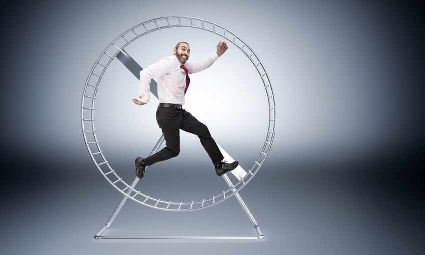 3D Rendering Run Hamster Businessman Man Worker Challenge Business Competition Race Concept Wheel Hurry Slave Work Routine Job Gear Motivation Stress Exercise Power Caucasian Manager Speed Office Career Hardworking Time Success Loop Active Urgency Unsuccessful Energy Exhausted Inefficient Tired Frustration Runner Powering Generation Production Happy Smile Jump