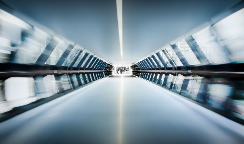 A picture taken inside the new crossrail station at Canary Wharf. The effect was achieved by using a long exposure and zooming the lens. Amazing Architecture Beautiful Blue Blur Built Structure Canary Wharf Color Crossrail Day Effect Horizontal Indoors  Light London Low Angle View Motion No People Reflection Symmetry