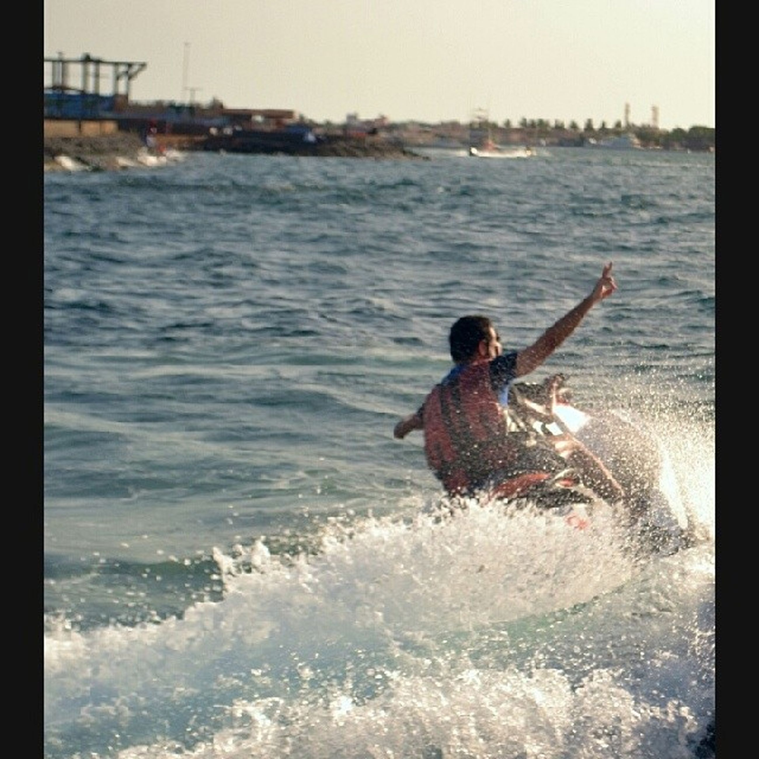 water, lifestyles, sea, leisure activity, waterfront, men, nautical vessel, rippled, holding, transportation, auto post production filter, mode of transport, sunlight, boat, nature, motion, outdoors, vacations