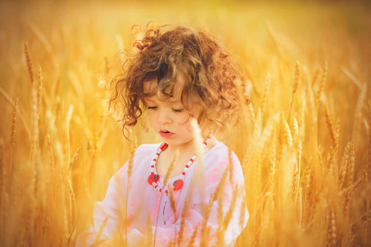 Close-up of girl standing in farm