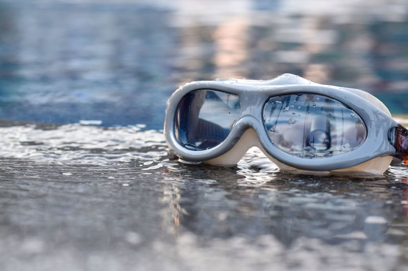 Close-up of goggles on swimming pool
