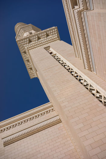 MEDINA, SAUDI ARABIA - 16TH NOV 2017; External view of minaret for Nabawi Mosque. Nabawi mosque is the second holiest mosque in Islam and built in 622. Architecture Calligraphy Carved Stones Eid Mubarak Faith In God Medina Al Munawarah Nabawi Mosque Peace And Quiet Prophet Muhammad Saudi Arabia Tradition Allah Arabic Blue Sky Decoration Eid Adha Heritage Building Holy Place Islam Minaret Mosque Muslim Ornaments Religion Tower