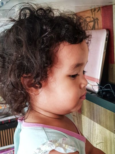 Focusing on something. Face Child Curly Hair Chubby Cheeks Chubby Girl Chubby Face Malaysian Focus Gaze Body Part