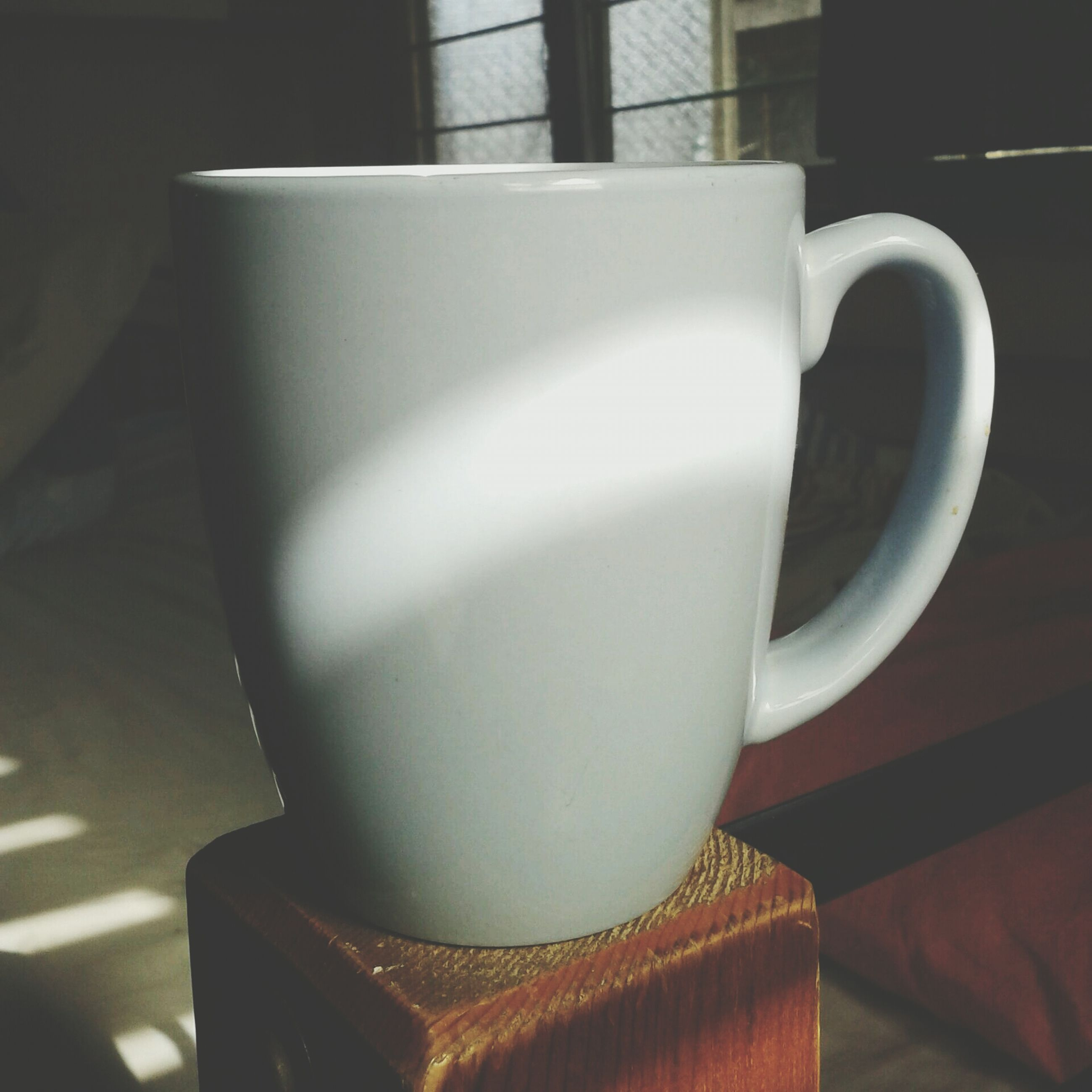 indoors, table, still life, coffee cup, close-up, no people, food and drink, high angle view, home interior, white color, drink, chair, cup, freshness, decoration, plate, design, day, absence, refreshment